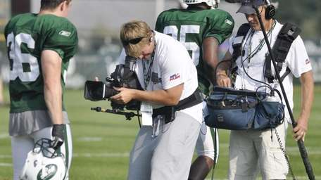 Safety Jim Leonhard, left, is filmed by a