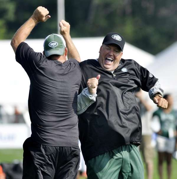 Head coach Rex Ryan, right, bumps outside linebacker