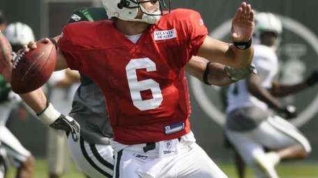 Mark Sanchez throws a pass during Jets training
