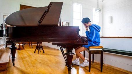Morgan Saint of Mattituck spends some private rehearsal