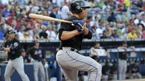 New York Mets batter Carlos Beltran watches his