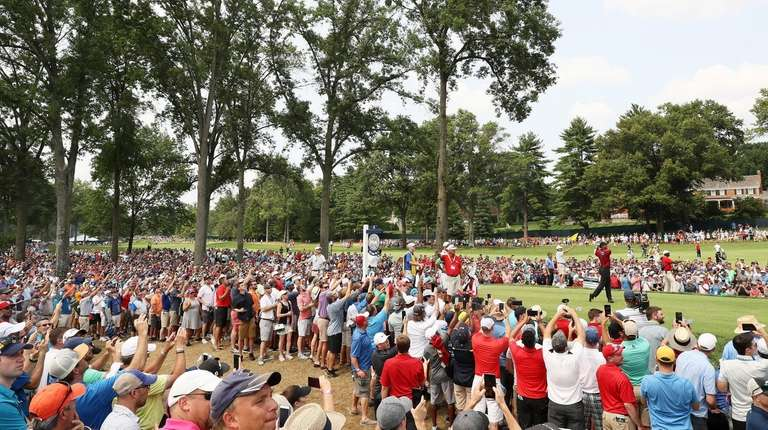 Tiger Woods plays his shot from the fifth