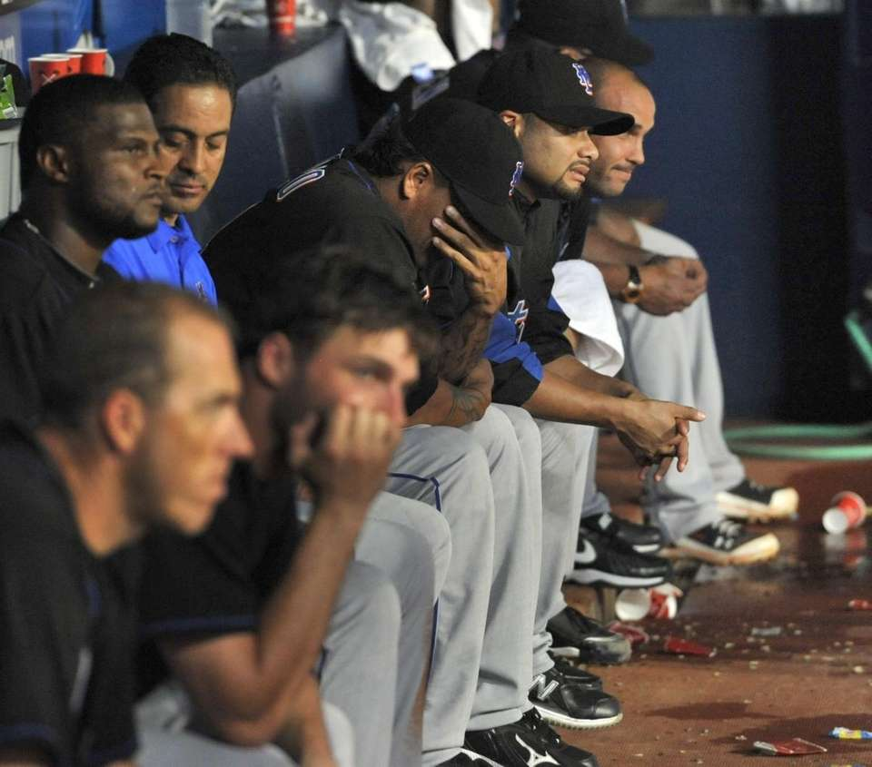 New York Mets look on from the dugout