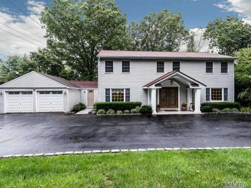 This Greenlawn Colonial includes four bedrooms and 3