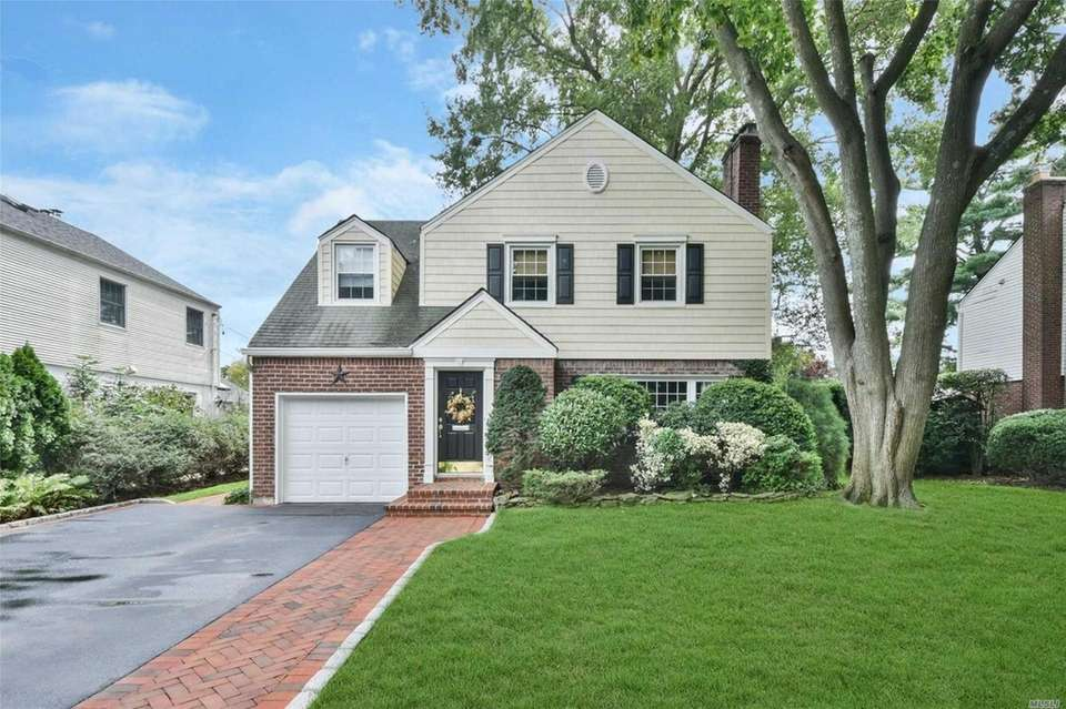 This Garden City Colonial includes three bedrooms and