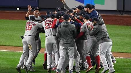 Red Sox players celebrate their win over the