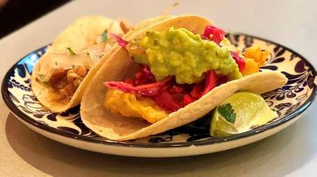 Tacos are filled with fried flounder, right, and