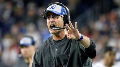 Colts coach Frank Reich signals from the sideline