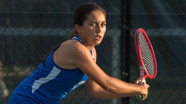 Port Washington's Andrea Martinez hits a return during