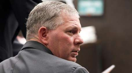 Lenny Dykstra sits during his sentencing for grand