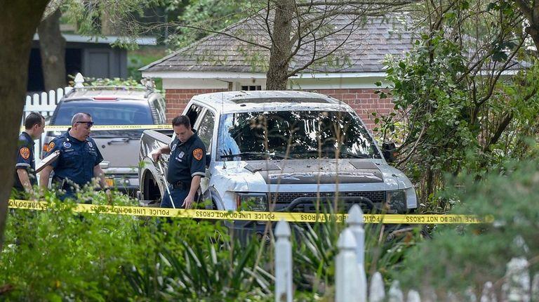Investigators check a fatal crash at a home