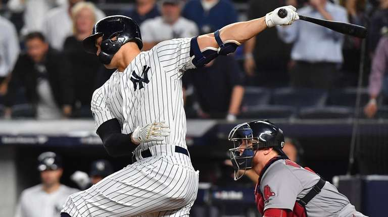 Yankees leftfielder Giancarlo Stanton strikes out in the