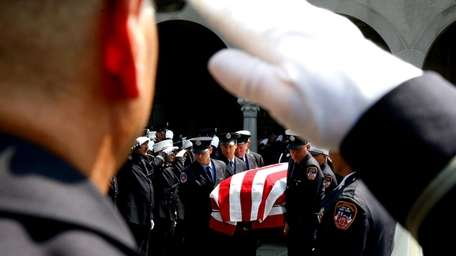 Firefighters carry the coffin of Vincent J. Albanese,