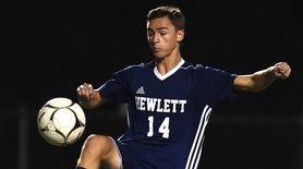 Hewlett's David Abikzer redirects a kick during the