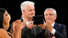 Then-Lakers assistant coach Tex Winter receives his NBA