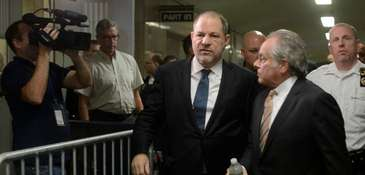 Harvey Weinstein, center, exits a courtroom at State