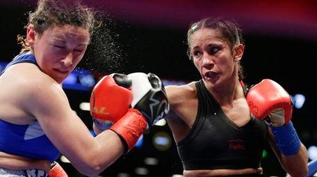 Amanda Serrano, right, punches Yamila Esher Reynoso during