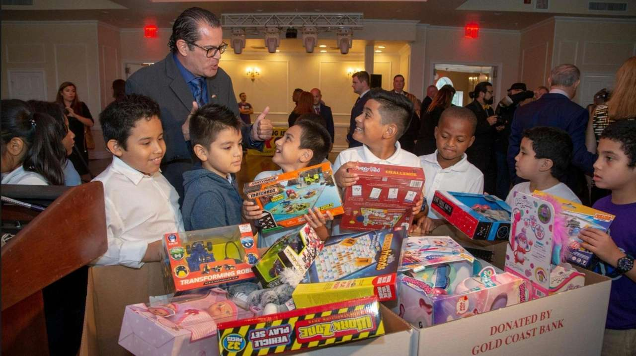 Toys for Tots co-chair Sean Acosta spoke on