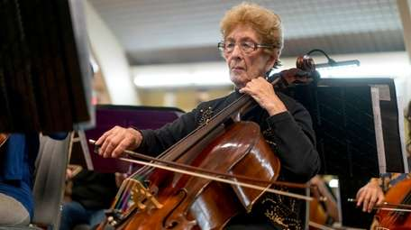 Evelyn Carlin, 88, of Wantagh, plays the cello