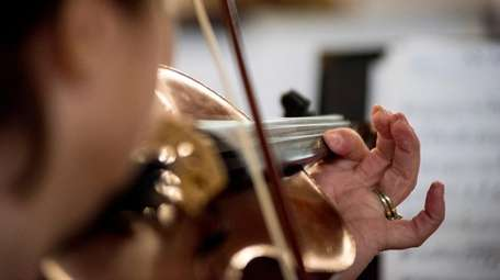 Picking up the violin, or viola, or cello,