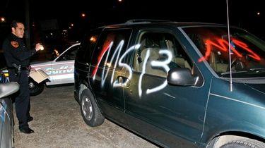A Suffolk County police officer checks a car