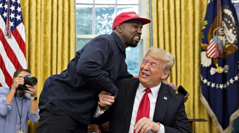 Rapper Kanye West shakes hands with President Donald