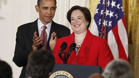 President Barack Obama applauds U.S. Solicitor General Elena