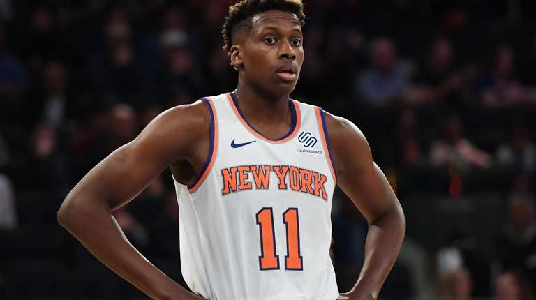 New York Knicks guard Frank Ntilikina looks on