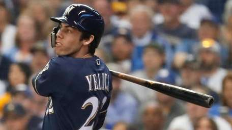 The Brewers' Christian Yelich hits a two-run home