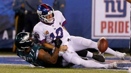 Giants quarterback Eli Manning is sacked by the