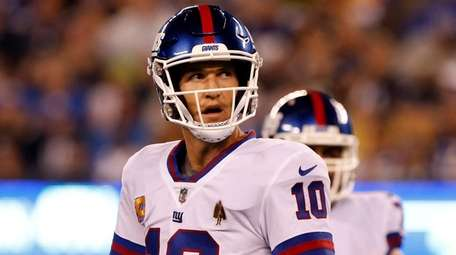 Giants quarterback Eli Manning looks on during a