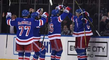 New York Rangers players celebrate their 3-2 overtime