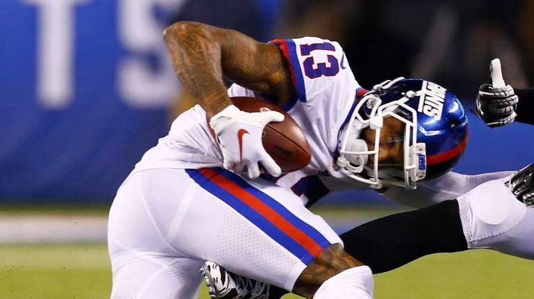Odell Beckham Jr. of the Giants is tackled