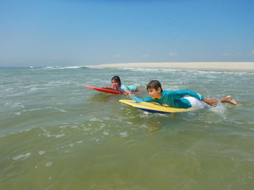 Thomas and Keira McCreery boogie boarding at Democrat
