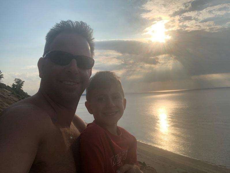 Father and son bonding time at sunset at