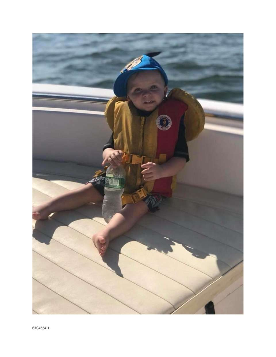 Cameron relaxing on Papa Ray's boat in the
