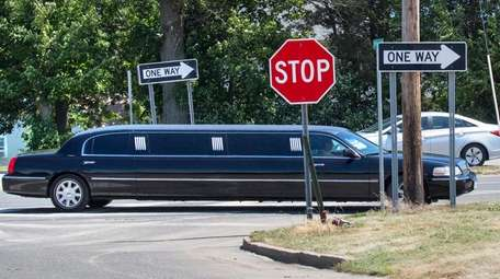 A limousine travels in Cutchogue on July 22,
