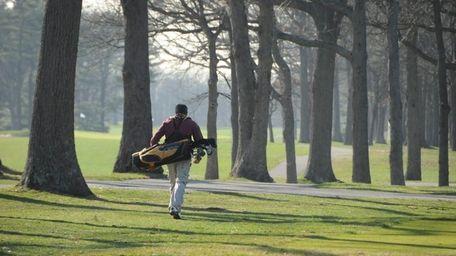 Golfers take advantage of the beautiful day at