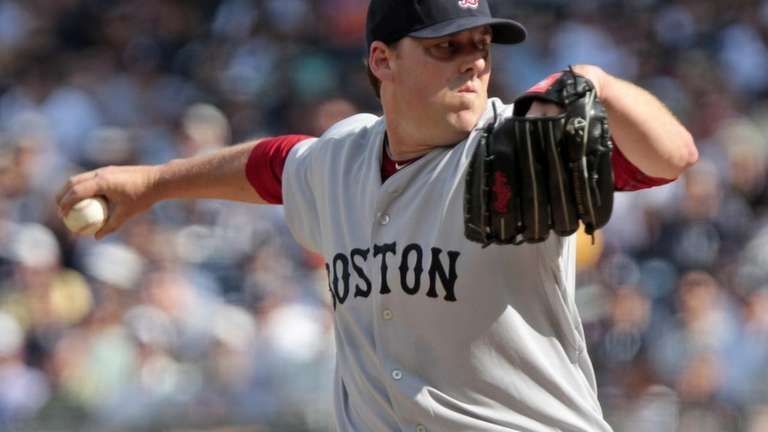 Boston Red Sox's John Lackey delivers a pitch