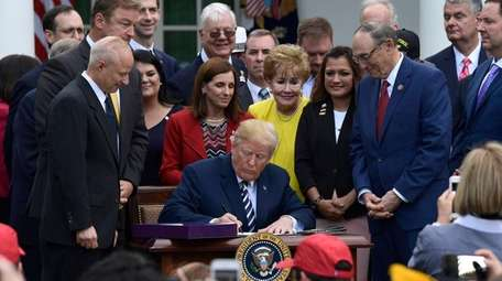 President Donald Trump signs the VA Mission Act