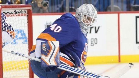 Islanders goaltender Robin Lehner slaps away the puck