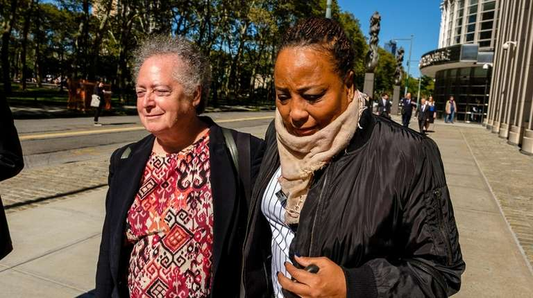 Former Assemb. Pamela Harris, right, leaves Brooklyn Federal