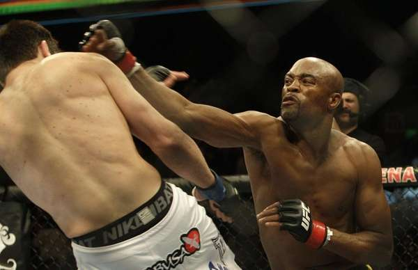 Anderson Silva, right, punches Chael Sonnen during the