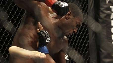 Phil Davis, top, punches Rodney Wallace during a