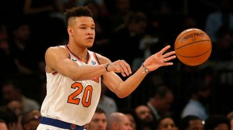 Kevin Knox of the New York Knicks controls