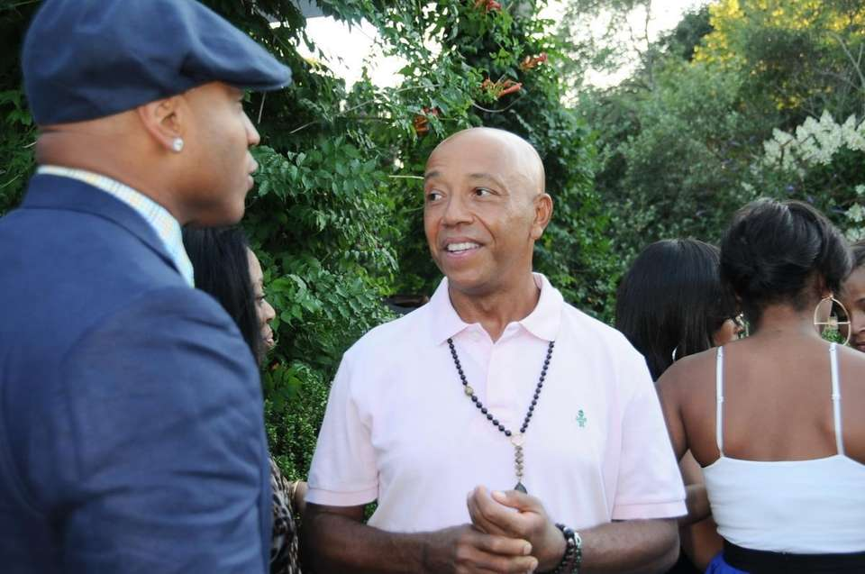 Russell Simmons, right, speaks with L.L. Cool J