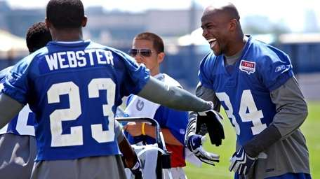 Deon Grant, right, shares a laugh with Corey