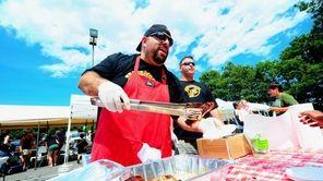 Rocco Camastro of Shake n Bake ribs serves