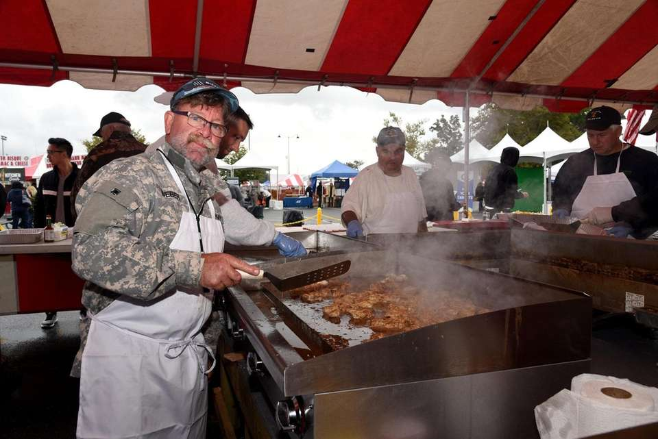 Rick Alfano fries the oysters for the Mill