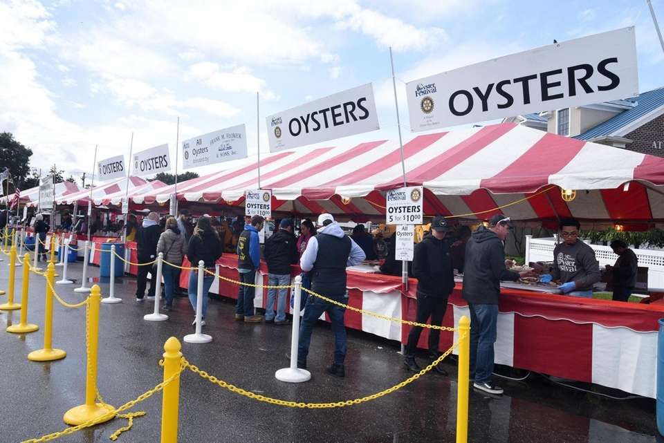 Oyster stands beckon hungry guests at the Oyster